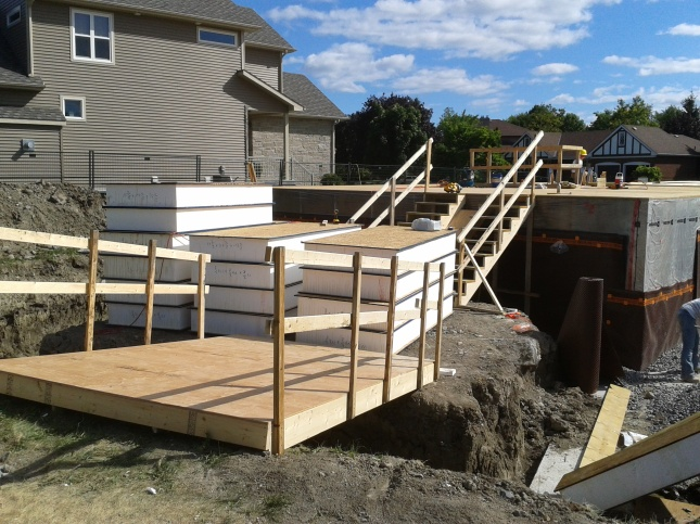 We quickly constructed a ramp and double-staircase to aid in moving the heavy panels.