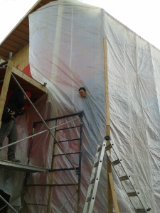 We tarped (and heated) the exterior in sections to apply the Stucco (EIFS)