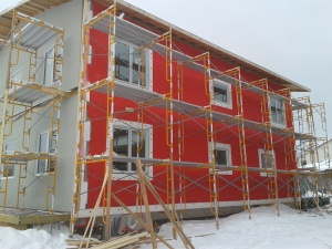 The water-proof layer under the EIFS was a festive RED... Sure got the neighbors talking!